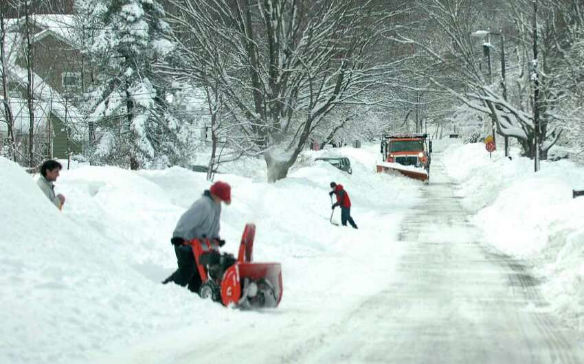 As residents try to clear their driveways, a snowplow heads up Millspaugh Dr. in Fairfield, Conn. on Thursday, Jan. 27, 2011, possibly making their job a little harder.