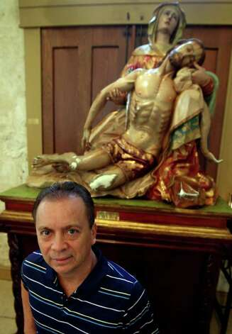 "Artist Agustin Parra stands in front of one of his works called ""La Piedad"" at San Fernando Cathedral. Photo: JOHN DAVENPORT/jdavenport@express-news.net"