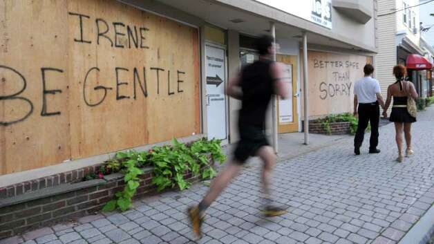 The owners of Private Studio Fitness on Greenwood Avenue in Bethel boarded up their windows Friday in anticipation of Sunday's expected hurricane. Thye included a message to Huricane Irene. Photo taken Friday, Aug. 26, 2011. Photo: Carol Kaliff