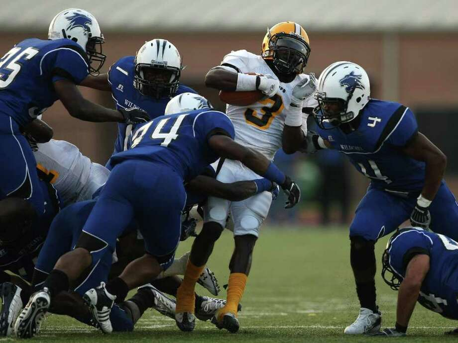 Dekaney's Myles Curl takes down Fort Bend Marshall's John Gibson. Photo: ERIC CHRISTIAN SMITH, FOR THE CHRONICLE