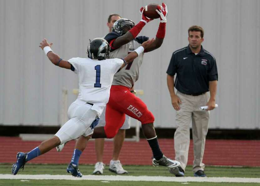 Dawson wide receiver (7) hauls in a catch over Clear Springs cornerback Jesse Washington in the firs