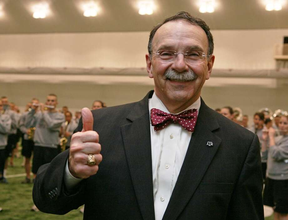A&M school president R. Bowen Loftin is all smiles here, but his school's potential move to the SEC doesn't make sense or cents, columnist Jerome Solomon writes.
