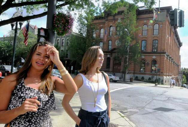 """Price Is Right"" winner Tatiana Echevarria,left, and friend Danielle Ingram take in the sights on Broadway in Saratoga Springs,NY Friday Aug. 26,2011.( Michael P. Farrell/Times Union) Photo: Michael P. Farrell"