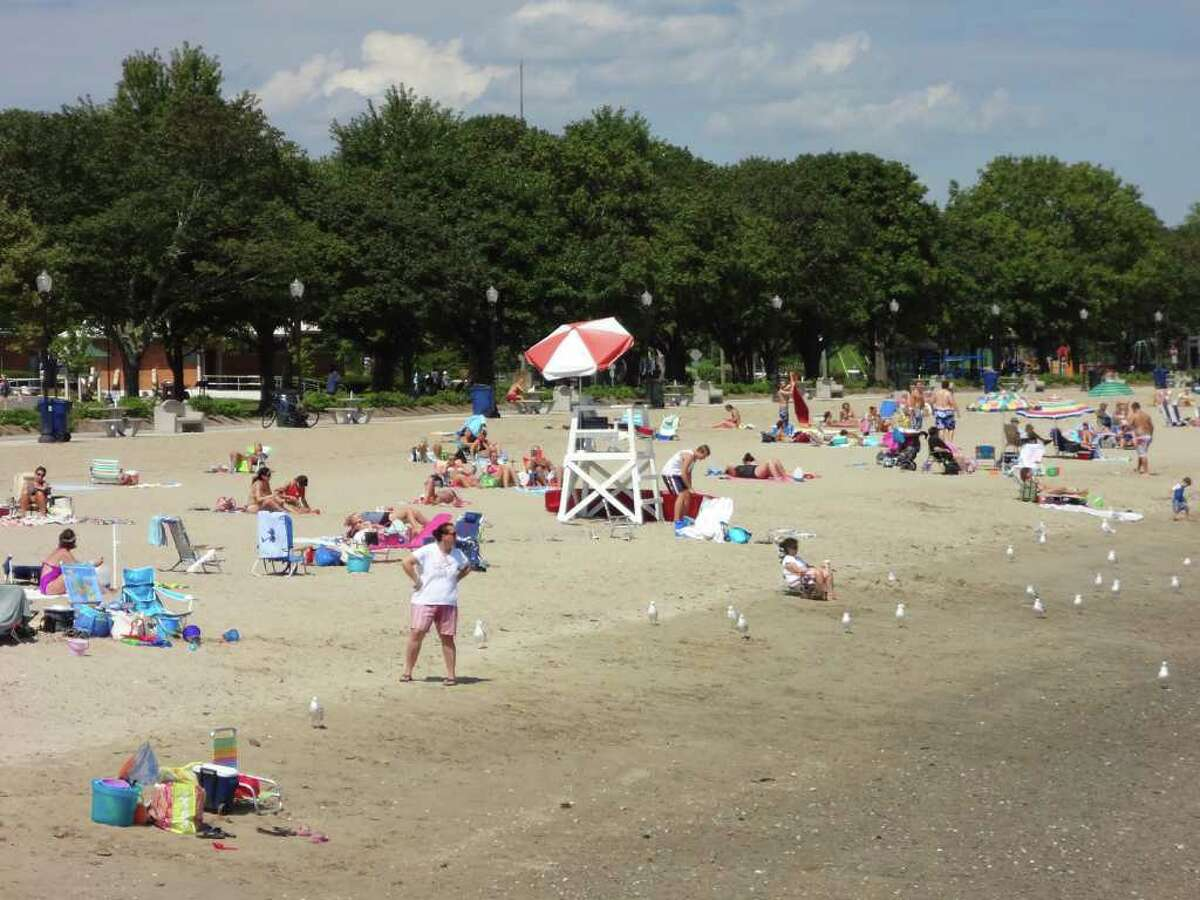 Norwalk residents enjoy the calm before the storm at Calf Pasture Beach in Norwalk on Friday, August 26, 2011.