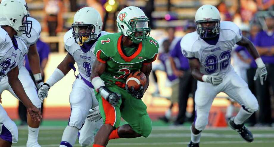 Hurricane running back Je Quan McBride splits the defense and runs into a wide open field for a touchdown in the first half as Brackenridge plays Sam Houston at Alamo Stadium  on August 26, 2011.    Tom Reel/Staff Photo: TOM REEL, Express-News / © 2011 San Antonio Express-News