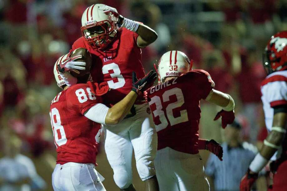 Katy receiver Jordan Thompson (3) celebrates with teammates Cody Gomez (32) and Stein Spiller (88) after he hauled in a long touchdown pass during the third quarter of Friday's season opener against North Shore. Katy won 34-6. Photo: Smiley N. Pool, Houston Chronicle / © 2011  Houston Chronicle