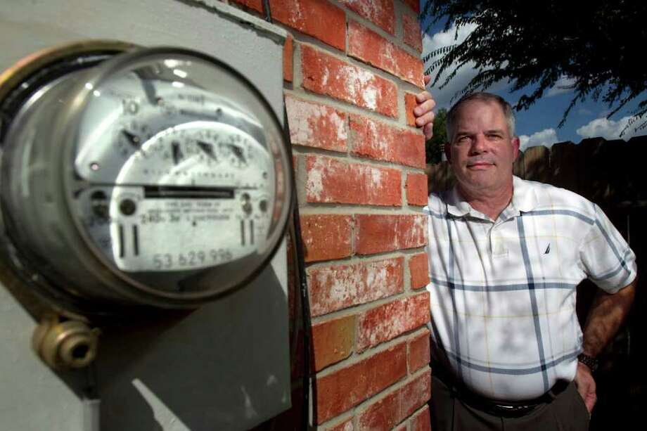 John Wheat, of Sugar Land, found that a month-to-month electricity plan became more expensive than he expected. (Photo by Johnny Hanson/Chronicle ) Photo: Johnny Hanson, Staff / © 2011 Houston Chronicle