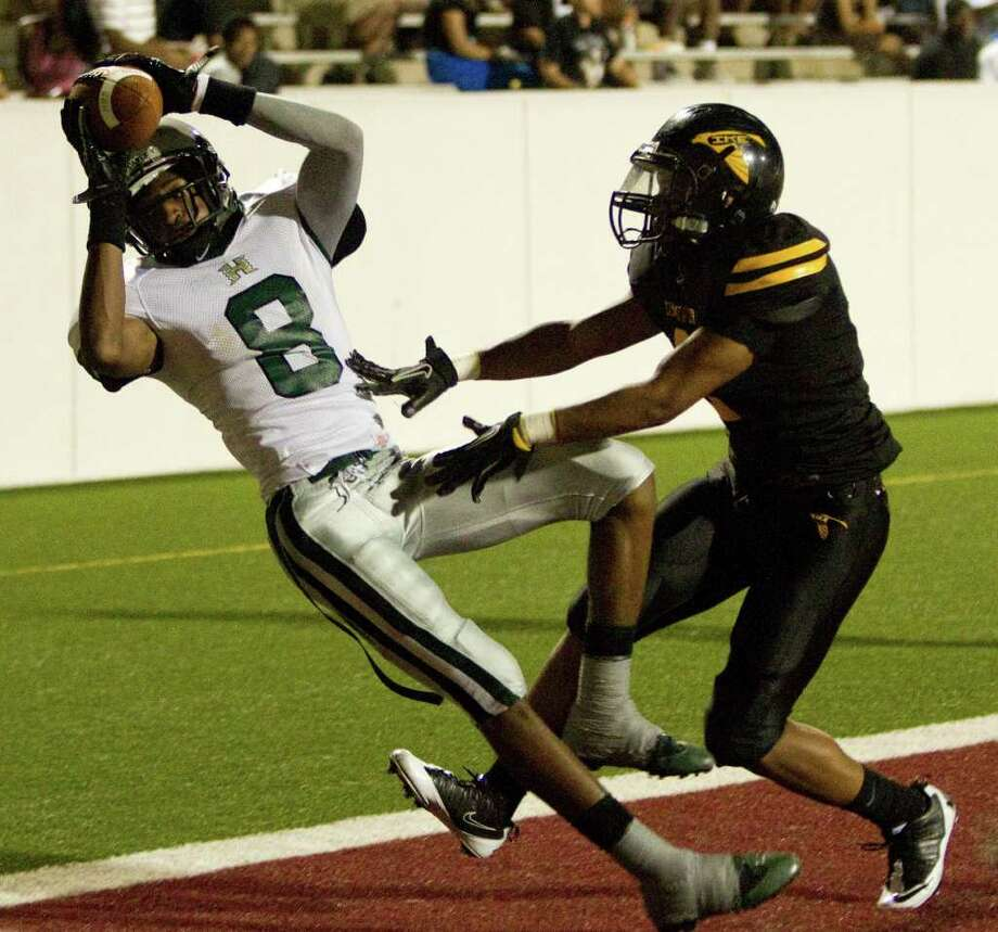 Hightower receiver Donald Weathersby (8) beats Eisenhower defensive back Cavian Davis for a touchdown during the third quarter. Photo: Brett Coomer, Houston Chronicle / © 2011 Houston Chronicle
