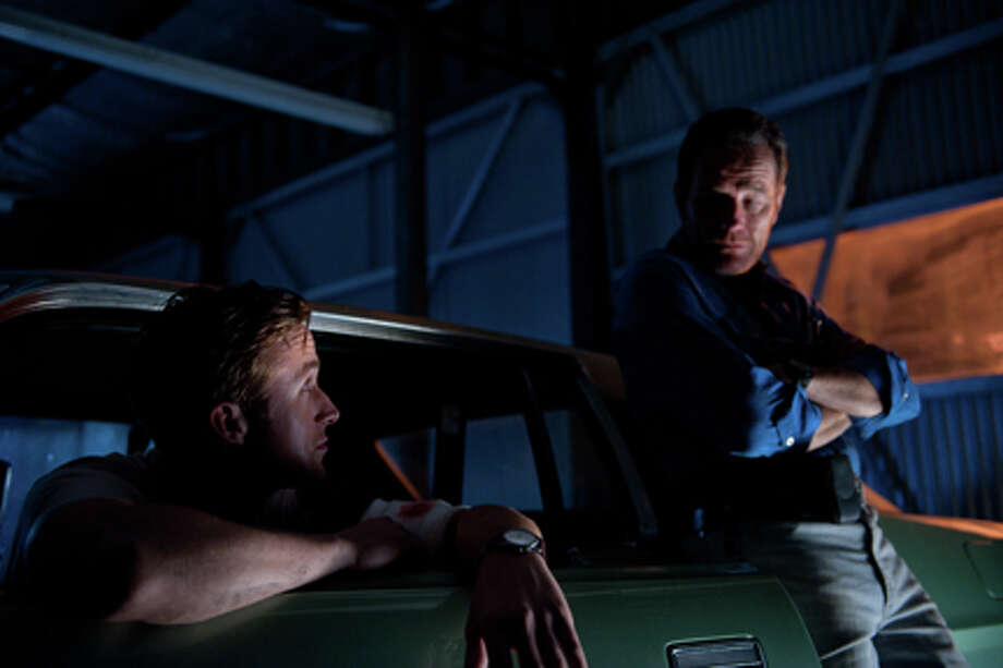 "(L-R) Ryan Gosling as Driver and Bryan Cranston as Shannon in ""Drive."" Photo: RICHARD FOREMAN JR  SMPSP"