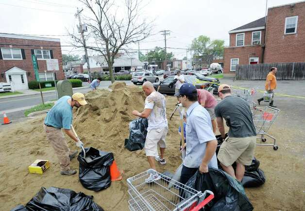 People fill sandbags in preparation for Hurricane Irene at the Sound Beach Fire Department in Old Greenwich, Saturday morning, Aug. 27, 2011.  Irene is expected to hit the Greenwich area sometime Sunday. Photo: Bob Luckey / Greenwich Time