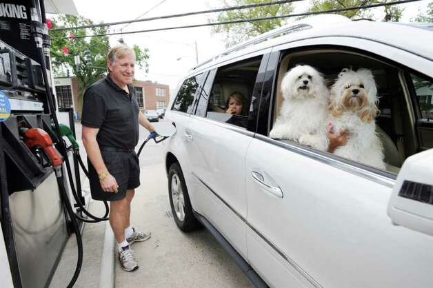 """I think this storm is going to surprise everyone,"" said Marshall Heaven of Greenwich as he topped off gas in his vehicle in preparation for Hurricane Irene at the Mobil in Old Greenwich, Saturday morning, Aug. 27, 2011.  In the back passenger seat is Marshall's daughter, Mary Alexandra Irene Heaven, 9, the dogs are Gabby, left, and Bailey.  Seated behind the dogs is Marshall's wife, Mary Ann. Photo: Bob Luckey / Greenwich Time"