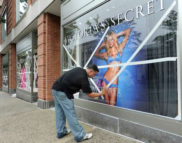 Paul Sayegh, building manager for 200 Greenwich Ave., tapes over the Victoria's Secret window in preparation for Hurricane Irene, Saturday afternoon, Aug. 27, 2011.  The storm is expected to hit the Greenwich area some time Sunday. Photo: Bob Luckey / Greenwich Time