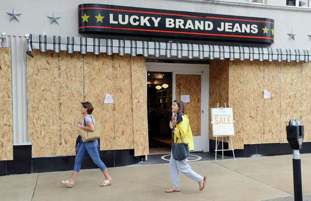 Boarded-up windows at the Lucky Brand Jeans store on Greenwich Ave. in preparation for Hurricane Irene, Saturday morning, Aug. 27, 2011. Photo: Bob Luckey / Greenwich Time