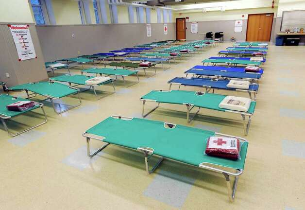 Cots, courtesy of the American Red Cross Greenwich Chapter, are available for persons displaced by Hurricane Irene, in the community room located in the basement at the Western Greenwich Civic Center, Saturday afternoon, Aug. 27, 2011. Photo: Bob Luckey / Greenwich Time