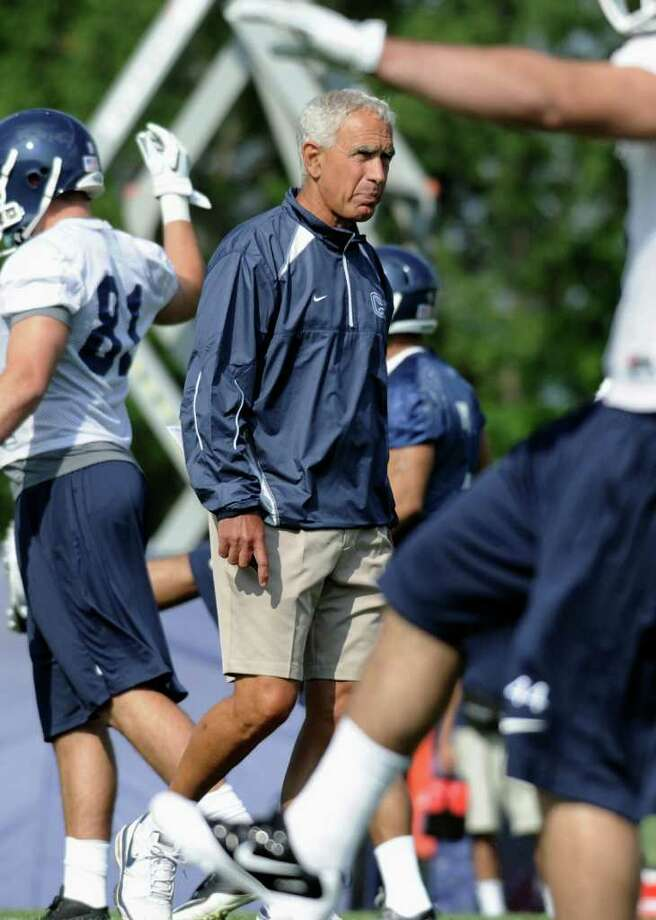 Connecticut coach Paul Pasqualoni watches his players during the first NCAA college football practice of the season at the University of Connecticut in Storrs, Conn., Friday, Aug. 5, 2011. (AP Photo/Jessica Hill) Photo: Jessica Hill/Associated Press / AP2011