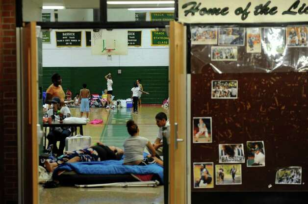 Local residents call the Bassick High School gymnasium home while Hurricane Irene makes its way up the East Coast and into New England in Bridgeport, Conn. on Saturday August 27, 2011. Photo: Christian Abraham / Connecticut Post