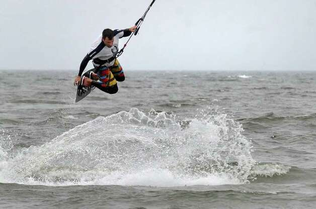 Mike Rosen, of Stratford, does some kite surfing with friends who live along Seaview Avenue in Milford, Conn. on Saturday August 27, 2011. Photo: Christian Abraham / Connecticut Post