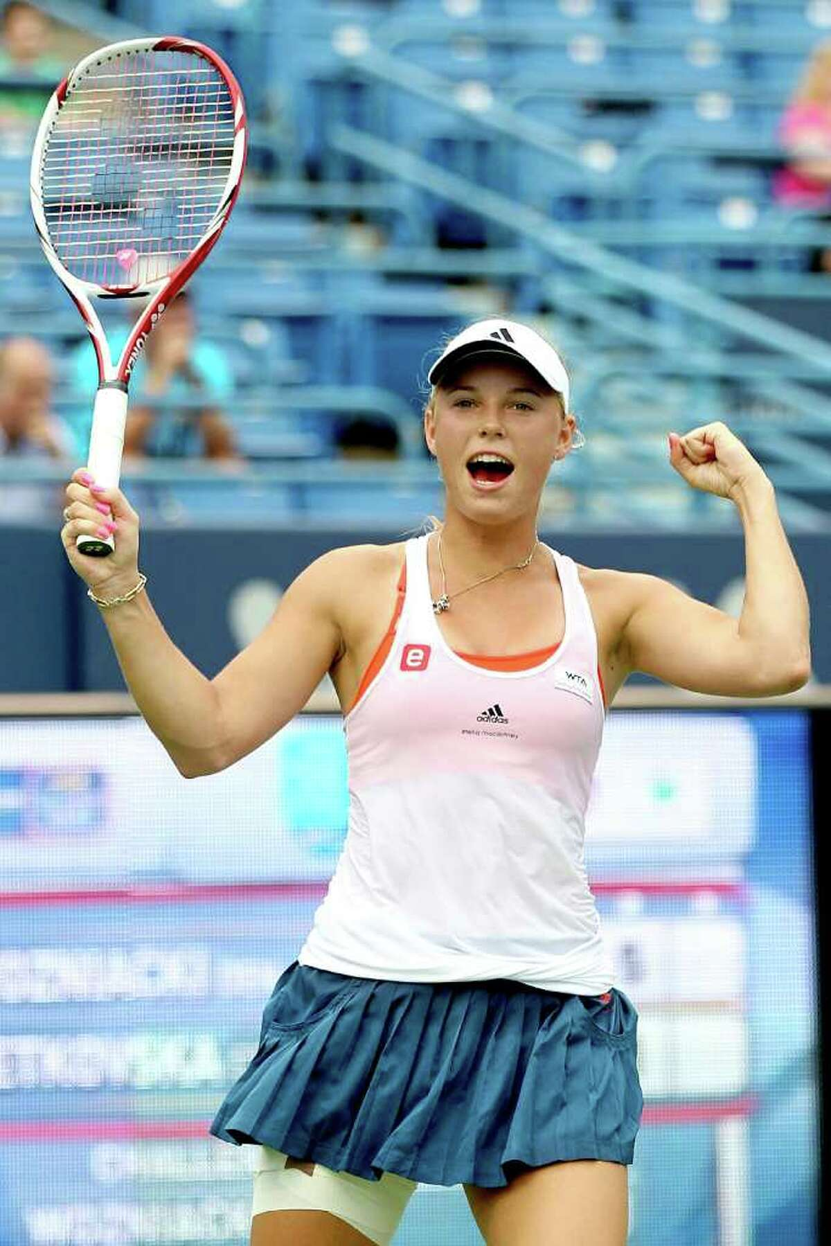 Caroline Wozniacki of Denmark celebrates match point against Petra Cetkovska of the Czech Republic during the final of the New Haven Open at Yale on Saturday. Wozniacki joined Venus Williams as the only players to win four straight New Haven events.