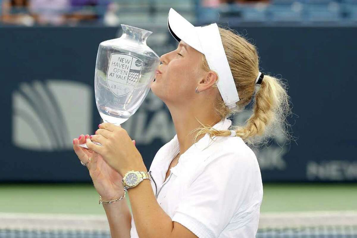 NEW HAVEN, CT - AUGUST 27: Caroline Wozniacki of Denmark poses with the winner's trophy after defeating Petra Cetkovska of the Czech Republic during the final of the New Haven Open at Yale presented by First Niagara at the Connecticut Tennis Center on August 27, 2011 in New Haven, Connecticut. (Photo by Matthew Stockman/Getty Images)