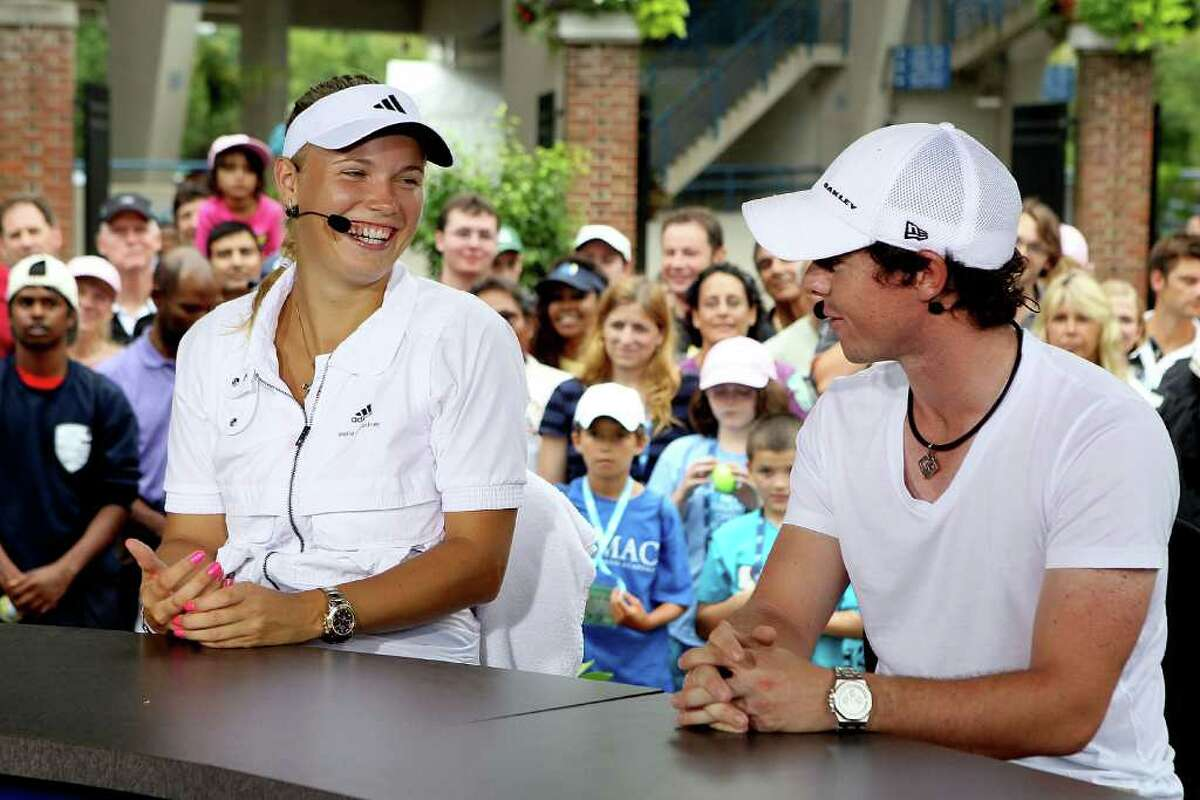 NEW HAVEN, CT - AUGUST 27: Caroline Wozniacki of Denmark and Rory McIlroy appear on the EPSN Game Day desk after her win over Petra Cetkovska of the Czech Republic during the final of the New Haven Open at Yale presented by First Niagara at the Connecticut Tennis Center on August 27, 2011 in New Haven, Connecticut. (Photo by Matthew Stockman/Getty Images)