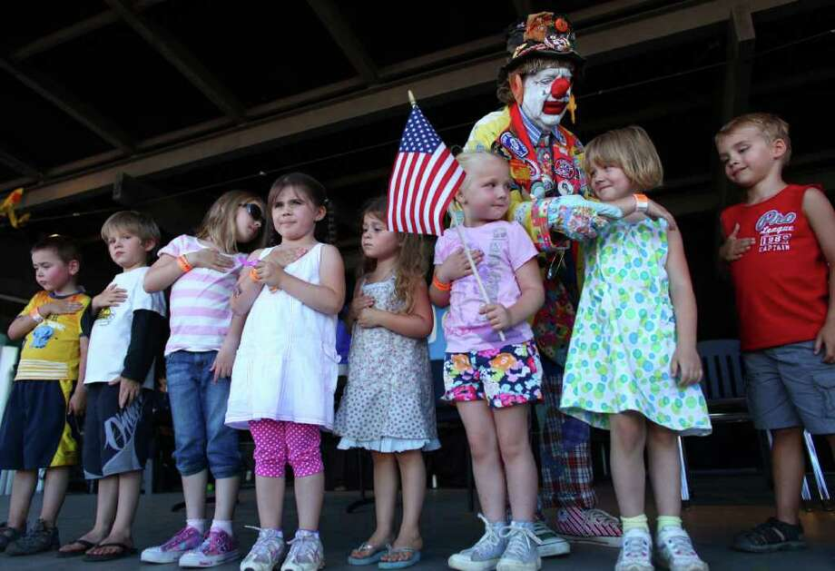 J.P. Patches helps kids say the Pledge of Allegiance during a performance on Saturday, August 27, 2011 at the Evergreen State Fair in Monroe. The appearance by the beloved clown was one of his final performances. The man behind the makeup, Chris Wedes, recently announced his retirement. J.P. Patches will have one final public performance on September 17th at the Fishermen's Fall Festival in Seattle. Photo: JOSHUA TRUJILLO / SEATTLEPI.COM