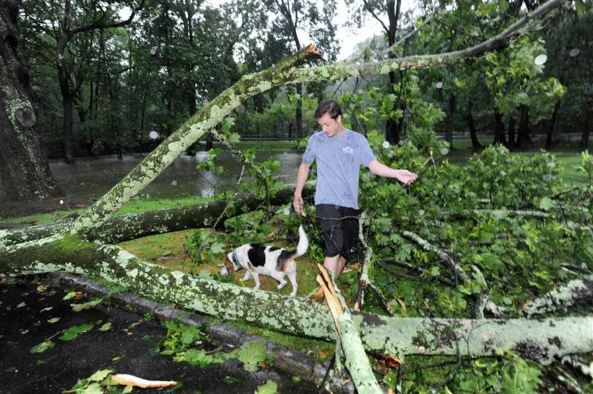 Aaron Klipstein and his dog Toby inspect a downed tree and flooding on their property at 3 Hillside Road during Hurricane Irene, Sunday morning, Aug. 28, 2011.