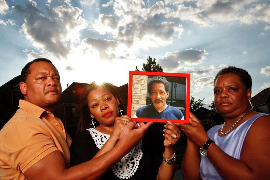 Norman Hicks Jr., left, Evangeline Campbell and Marie Fields are frustrated with the length of the investigation into the death of their father, Norman Ford Hicks, who died in January after he was involved in an altercation in jail. (Photo by Michael Paulsen/Chronicle) Photo: Michael Paulsen, Staff / © 2011 Houston Chronicle