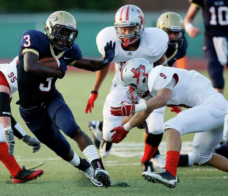 Klein Collins running back Marcus Goodman sidesteps Travis' Dillon Springer. Photo: Bob Levey, For The Chronicle / ©2011 Bob Levey