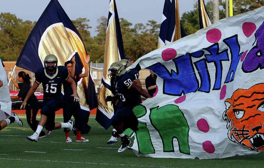 Klein Collins takes the field for the opener against Fort Bend Travis. Photo: Bob Levey / ©2011 Bob Levey