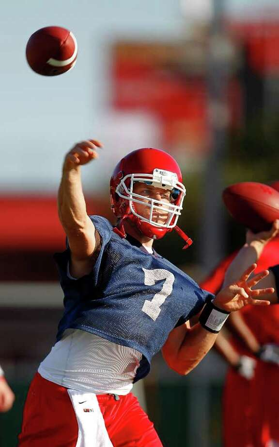 Quarterback Case Keenum, a sixth-year senior, embarks on what could be an unforgettable  season for him and the Coogs. Photo: Karen Warren, Staff / © 2011 Houston Chronicle