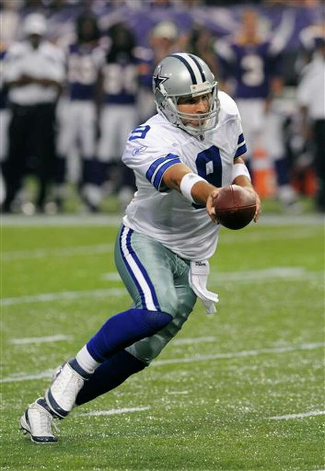 Dallas Cowboys quarterback Tony Romo hands the ball off during the first half of an NFL preseason football game against the Minnesota Vikings Saturday, Aug. 27, 2011, in Minneapolis. (AP Photo/Jim Mone) Photo: Associated Press