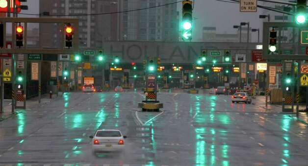The  Holland Tunnel is seen nearly deserted as rain from the outer bands of Hurricane Irene soak up the area, Saturday, Aug. 27, 2011 in Jersey City, N.J.   (AP Photo/Julio Cortez) Photo: Julio Cortez