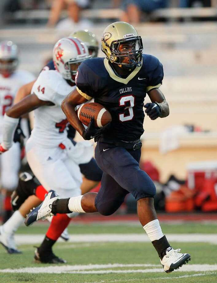 Klein Collins running back Marcus Goodson breaks loose for a 71-yard touchdown run in the first quarter of Saturday's game against Travis in Spring. Goodson rushed for 210 yards and three touchdowns to lead Klein Collins to a 42-13 win. Photo: Bob Levey / ©2011 Bob Levey