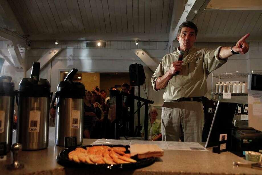 "Governor Rick Perry speaks during a ""meet and greet"" at The Vine Coffeehouse in Ottumwa, Iowa, Aug. 27, 2011. Photo: LISA KRANTZ, LISA KRANTZ/lkrantz@express-news.net / SAN ANTONIO EXPRESS-NEWS"