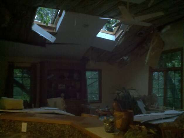 A tree fell into this house in Orange, August 28, 2011. Photo: Alex Papadopoulos/WTNH Report It