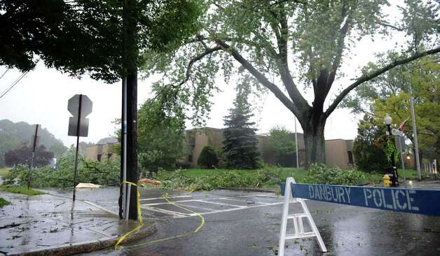 Police block off the area near the old police station early Sunday morning because of fallen tree branches due to the wind and rain of Hurricane Irene. Photo taken Sunday, Aug. 28, 2011. Photo: Carol Kaliff
