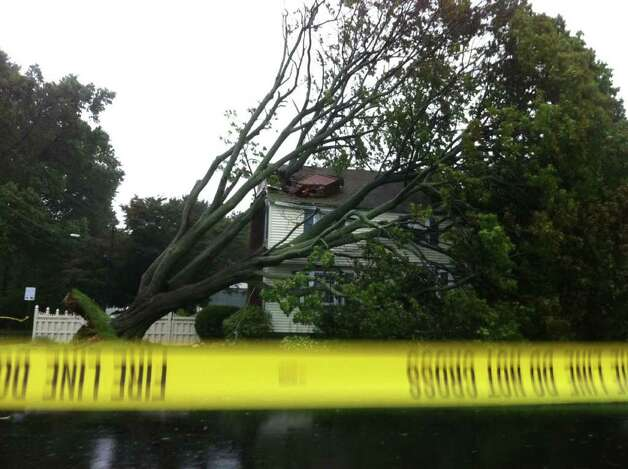 A tree fell on a house on Lake Avenue in Bridgeport, Conn. as a result of winds brought by Hurricane Irene on Sunday, August 28, 2011. Photo: Brett Mickelson