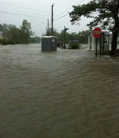 Portable bathrooms -- and everything else -- was swamped along Fairfield Beach Road on Sunday morning as Hurricane Irene moved in. Photo: Genevieve Reilly / Fairfield Citizen
