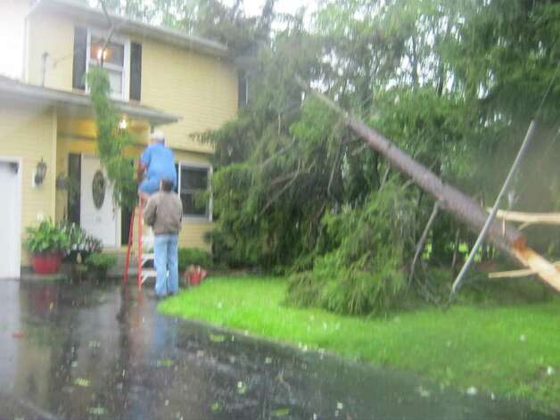 This tree fell on Jeanne and Robert Salisbury's home on Kenwood Avenue in Bethlehem around 9 a.m. Sunday as Tropical Storm Irene pounded the Capital Region. (Lauren Stanforth/Times Union)