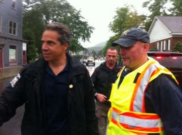 Gov. Andrew Cuomo surveys storm damage in Albany on Sunday, Aug. 28, 2011. (Jimmy Vielkind/Times Union)