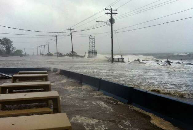 Waves from Long Island Sound caused by Hurricane Irene crash onto the road in front of Chick's restaurant along Beach Avenue in West Haven, Conn. on Sunday August 28, 2011. Photo: Christian Abraham