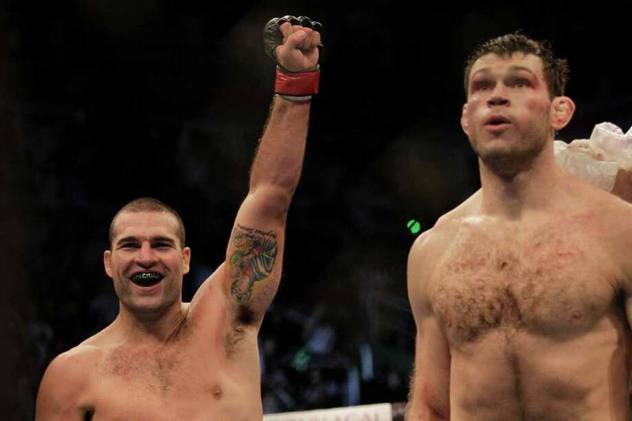Brazil's Shogun Rua, left, celebrates after defeating Forrest Griffin in the first round. Photo: Felipe Dana, Associated Press / AP
