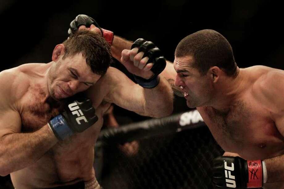 Shogun Rua throws an overhand right to Forrest Griffin. Photo: Felipe Dana, Associated Press / AP