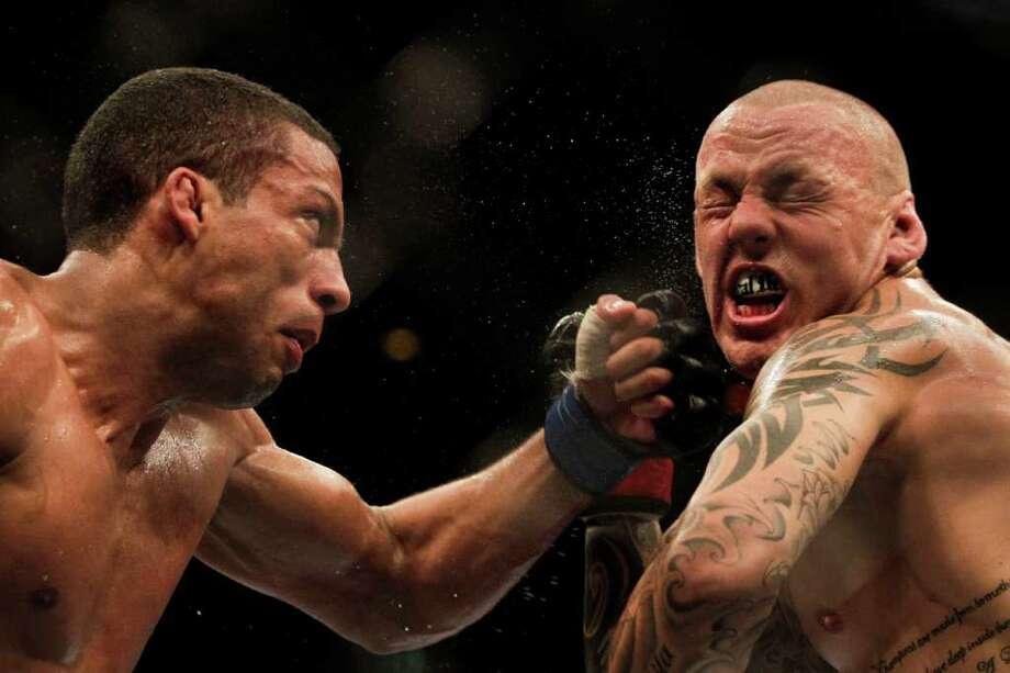 Edson Barboza punches Ross Pearson during UFC 134 in Rio de Janeiro, Brazil. Photo: Felipe Dana, Associated Press / AP
