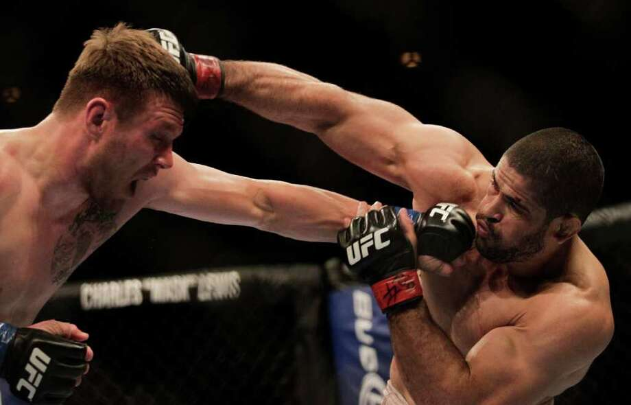 Dan Miller connects on a punch to Rousimar Palhares. Photo: Felipe Dana, Associated Press / AP