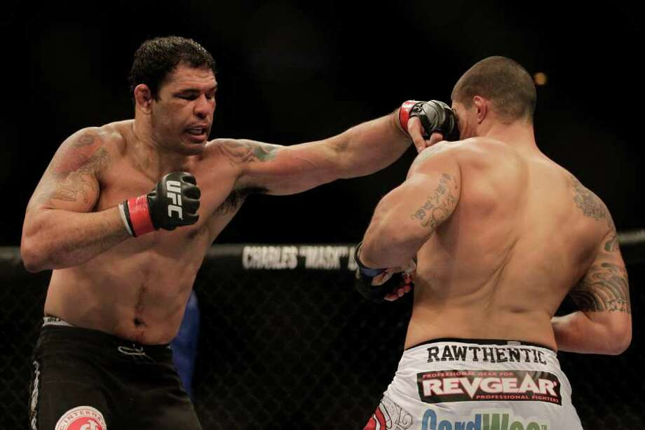 Minotauro Nogueira reaches out to hit Brendan Schaub. Photo: Felipe Dana, Associated Press / AP