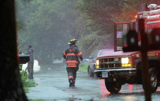 A Greenwich firefighter goes door-to-door evacuating residents on Monica Road in Pemberwick during Hurricane Irene, Aug. 28, 2011. Photo: Bob Luckey / Greenwich Time