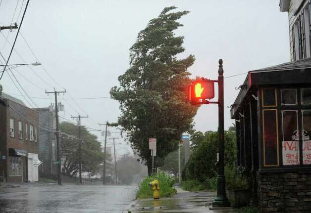 A tree bends in the wind on South Water Street, Byram, during Hurricane Irene, Aug. 28, 2011. Photo: Bob Luckey / Greenwich Time