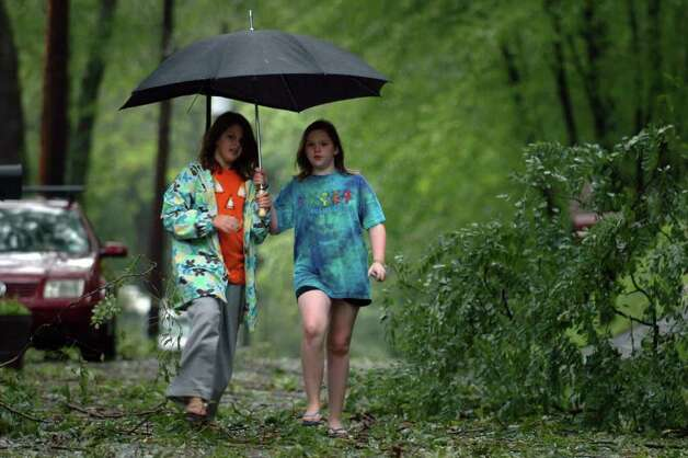 Fiona Kyle and Gwen Dascenzo, both 11, walk along Circle Dr. in Stratford, Conn. Aug. 28th, 2011. Photo: Ned Gerard
