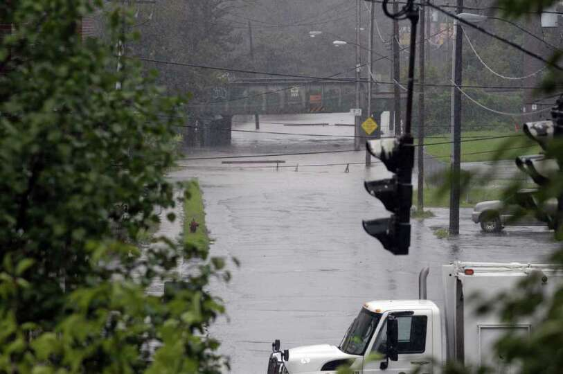 Weaver Street off Broadway is flooded as Tropical Storm Irene hit the Capital Region on Sunday, Aug.
